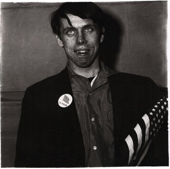 01_Arbus-patriotic-young-man-with-a-flag-nyc-1967